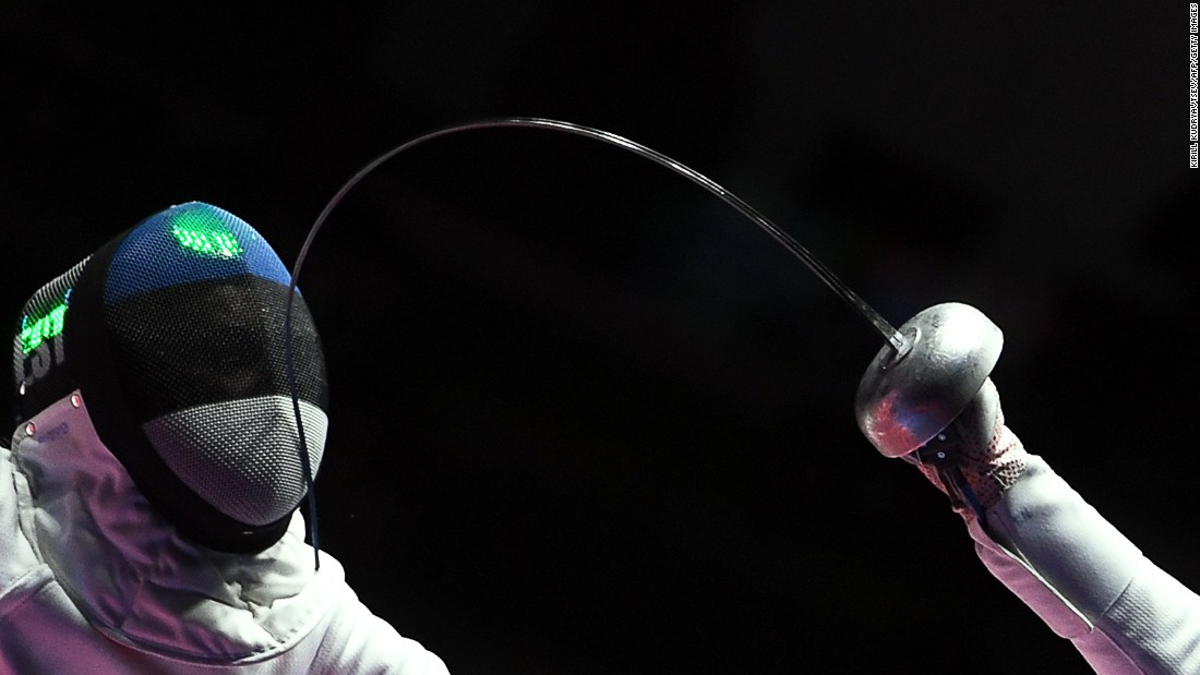 Estonian fencer Irina Embrich, left, competes in the team epee event.