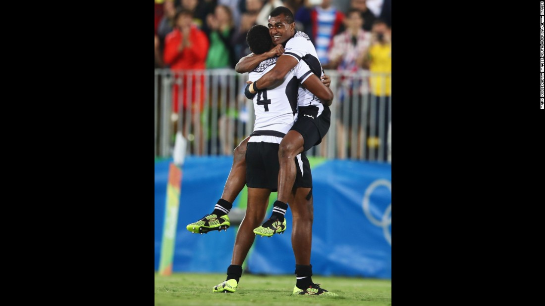 "Apisai Domolailai and Viliame Mata celebrate after Fiji <a href=""http://www.cnn.com/2016/08/11/sport/fiji-rugby-olympics-sevens-rio-2016/index.html"" target=""_blank"">won its first-ever Olympic medal</a> with a 43-7 victory over Great Britain in the rugby sevens final."