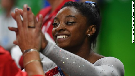 US gymnast Simone Biles reacts after seeing her score in the uneven bars event of the women's individual all-around final of the Artistic Gymnastics at the Olympic Arena during the Rio 2016 Olympic Games in Rio de Janeiro on August 11, 2016. / AFP / Ben STANSALL        (Photo credit should read BEN STANSALL/AFP/Getty Images)