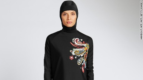"In a recent undated handout picture released by British retailer Marks and Spencer on April 8, 2016 a model poses wearing one of Marks and Spencer's full-body bathing suit or burkini suit. From young start-ups to business giants, British entrepreneurs are eyeing a rapidly expanding global market for Muslim consumers with a range of brands from clothes to greetings cards to online gym courses. In contrast to France, where there has been an angry debate about Muslim-specific consumer products, the approach in Britain seems more business-minded. For example, famous names like the Marks & Spencer department store chain now offer Islamic fashion products.   / AFP PHOTO / MARKS AND SPENCER / Handout / RESTRICTED TO EDITORIAL USE - MANDATORY CREDIT  "" AFP PHOTO / MARKS AND SPENCER ""  -  NO MARKETING NO ADVERTISING CAMPAIGNS   -   DISTRIBUTED AS A SERVICE TO CLIENTS HANDOUT/AFP/Getty Images"