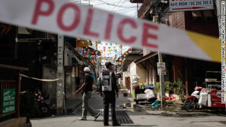 HUA HIN, THAILAND - AUGUST 12: Thai police officers stand at the site of an explosion on Friday, August 12, 2016 in Hua Hin, Thailand. A series of coordinated blasts across Southern Thailand including Hua Hin and Phuket killing at least four people and injured dozens over the last 24 hours. According to reports, no group has claimed the attacks but suspicion has fallen on separatist insurgents.. (Photo by Dario Pignatelli/Getty Images)