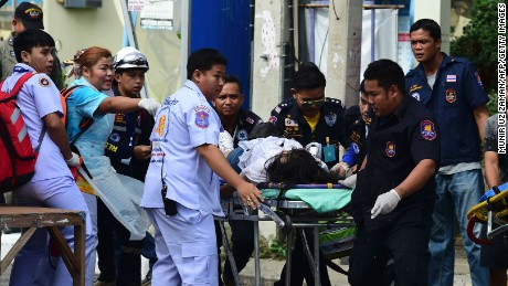 Thai rescue workers attend to an injured victim after a small bomb exploded in Hua Hin on August 12, 2016. A string of bomb attacks targeting Thailand's crucial tourism industry have killed four people, officials said on August 12, sending authorities scrambling to identify a motive and find the perpetrators.