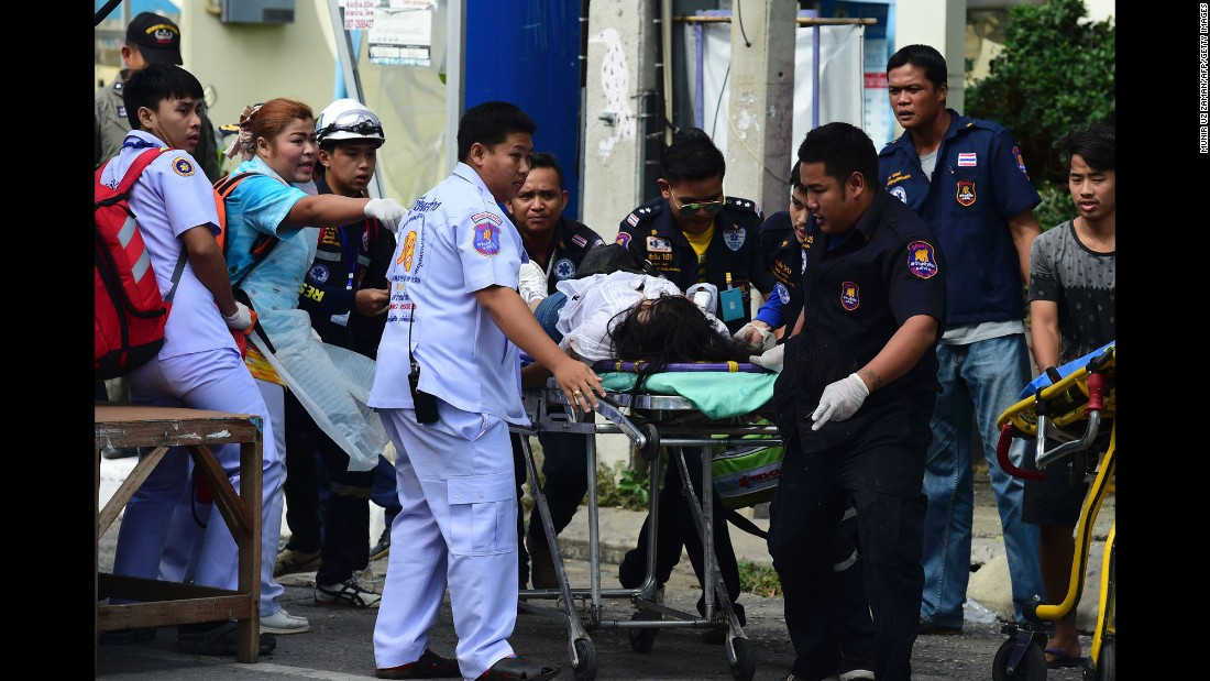 Thai rescue workers transport a bombing victim on a stretcher in Hua Hin, Thailand. Hua Hin is a popular coastal resort for both Thai and foreign visitors.