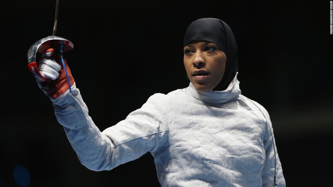 Ibtihaj Muhammad competed in the women's individual sabre, earning her the title of first U.S. athlete to compete wearing a hijab, a religious head covering sometimes worn by Muslim women.