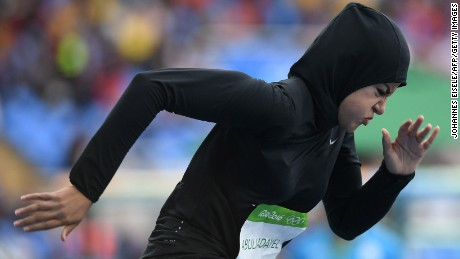 Saudi Arabia's Kariman Abuljadayel competes in the Women's 100m Preliminary Round during the athletics event. (first female sprinter representing the country, setting a new national record)