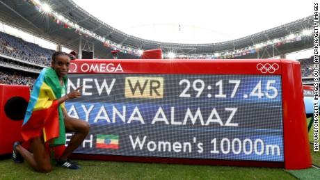 Ethiopia's Almaz Ayana celebrates winning the women's 10,000m final.