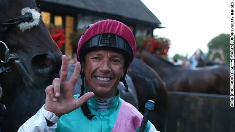 Frankie Dettori celebrates after riding his 3000th British winner on Predilection at Newmarket.