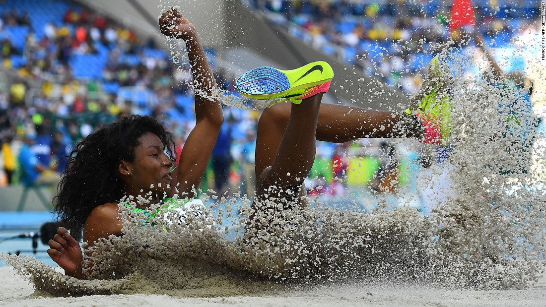 Brazil's Nubia Soares lands in the women's triple jump qualifying round.