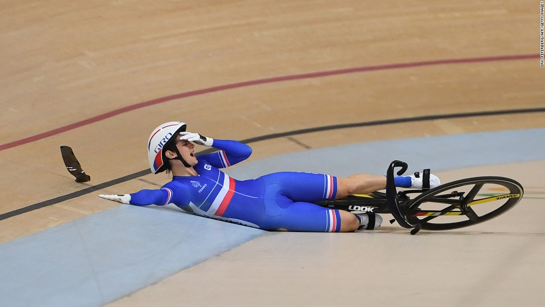 France's Virginie Cueff reacts after falling in the keirin first round track cycling event.