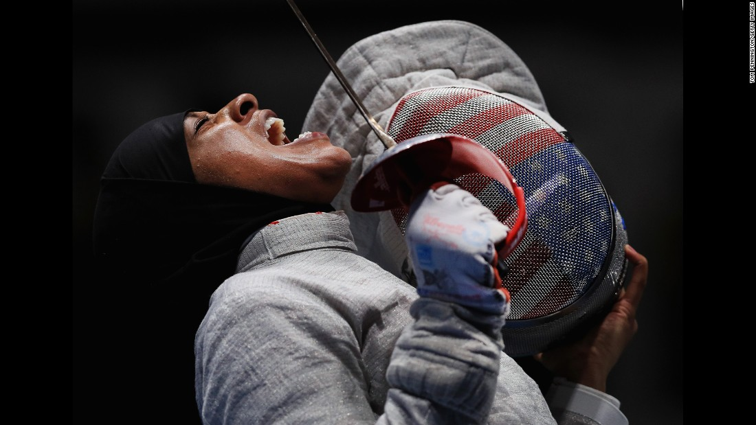 American fencer Ibtihaj Muhammad reacts during the women's saber team semifinal against Sofya Velikaya of Russia. The US went on to win bronze.