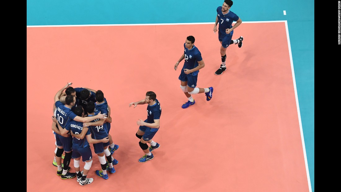 Argentina's players celebrate after winning their qualifying volleyball match against Cuba.