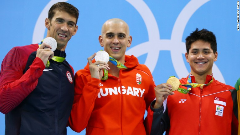 Joint silver medalists, Michael Phelps of United States and Laszlo Cseh of Hungary and gold medalist Joseph Schooling of Singapore celebrate on the podium during the medals ceremony in the Men's 100m butterfly final.