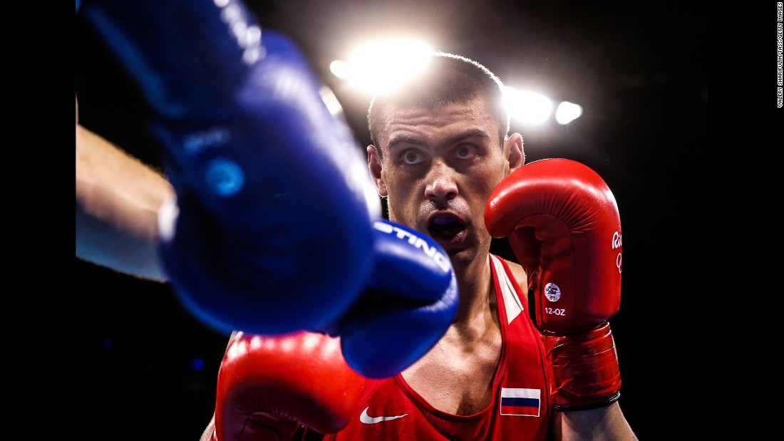 Russian boxer Evgeny Tishchenko won his heavyweight 91-kilogram (201-pound) semifinal bout against Uzbekistan's Rustam Tulaganov and will go for gold on Monday.