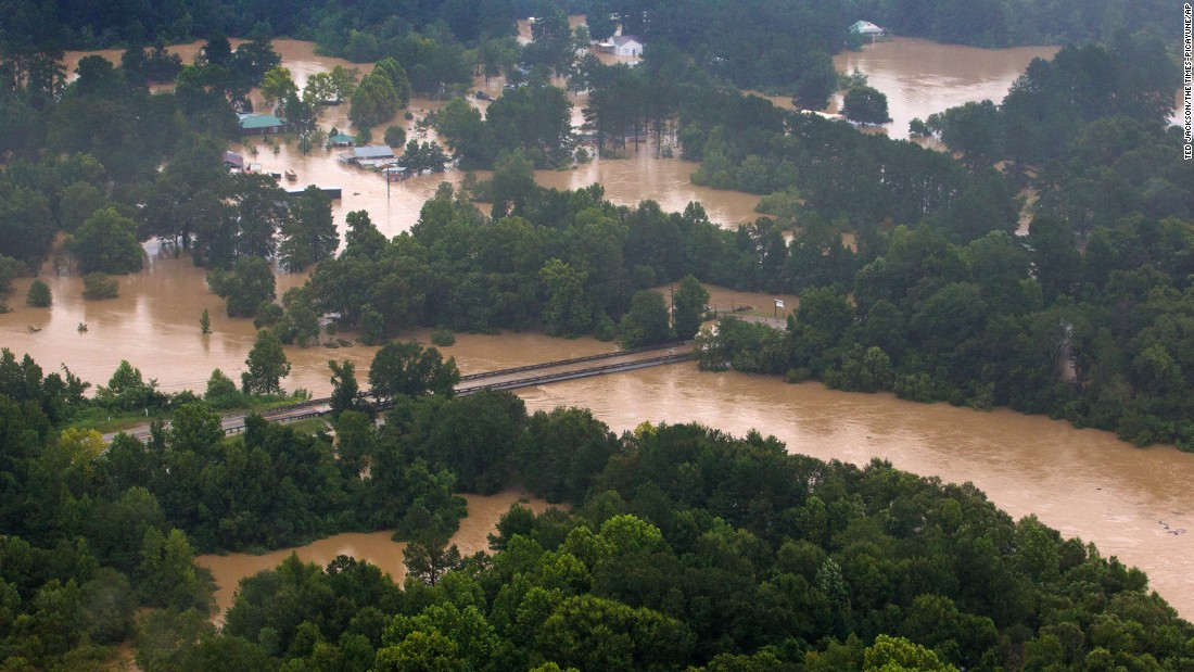 The Tangipahoa River overflows near the towns of Amite, Independence, Tickfaw and Robert on August 13.