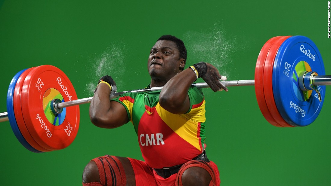 Weightlifter Petit David Minkoumba of Cameroon competes in the the 94-kilogram (207-pound) event.