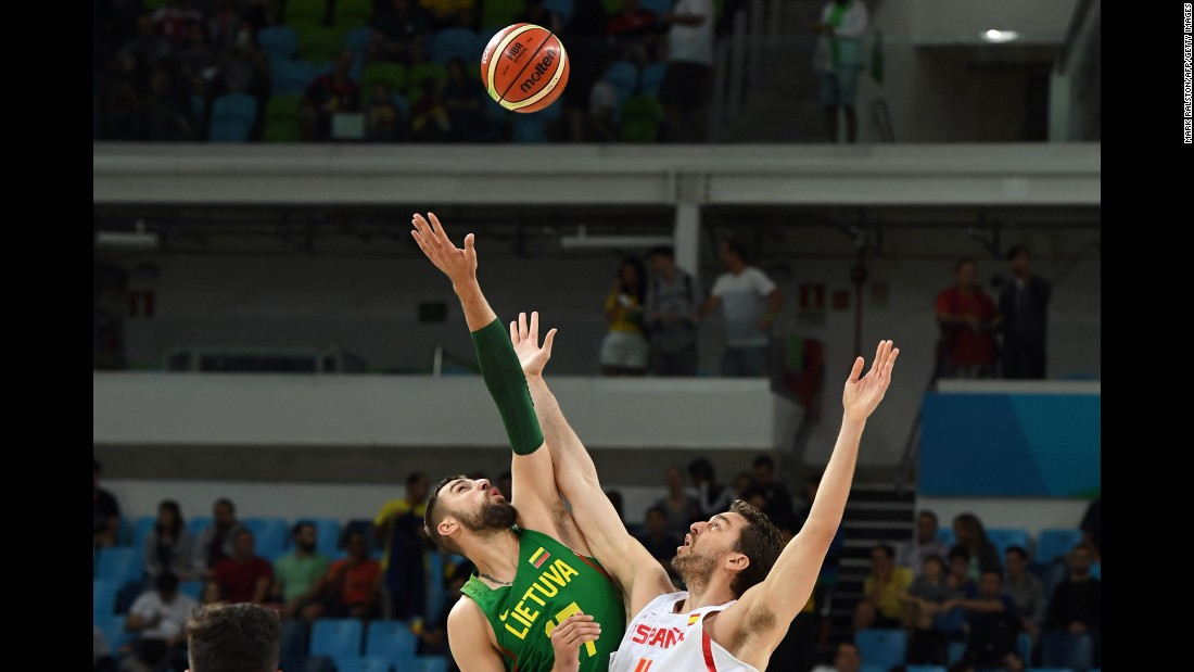 Jonas Valanciunas of Lithuania, left, and Spain's Pau Gasol face off in a preliminary basketball match. Spain won 109-59.