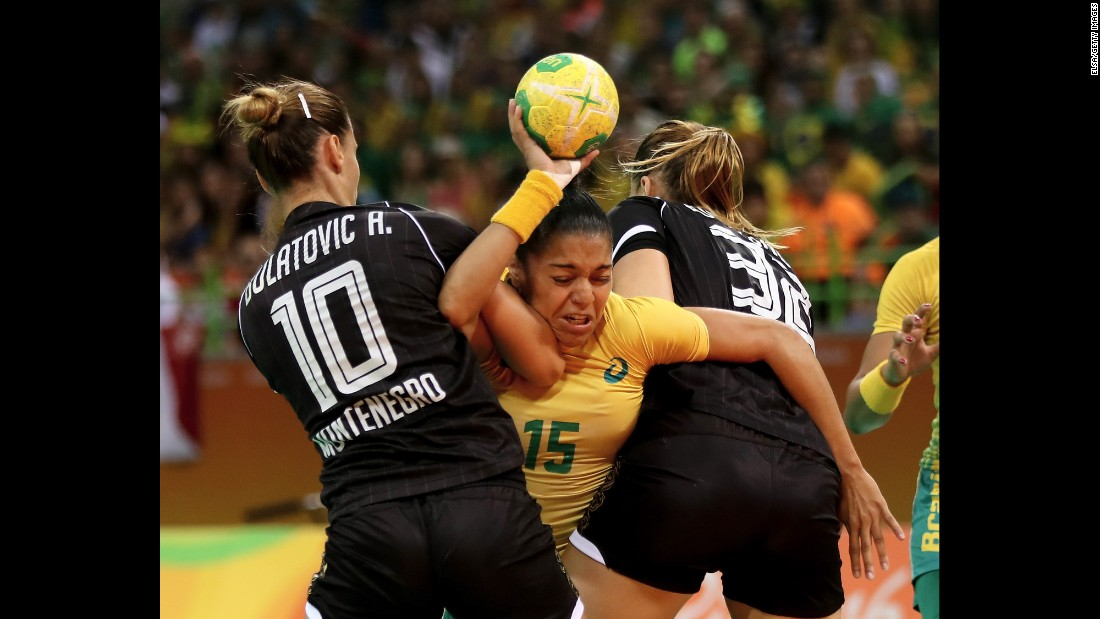 Francielle Rocha of Brazil, center, tries to get past Andela Bulatovic, left, and Katarina Bulatovic of Montenegro during a handball match between their two countries.