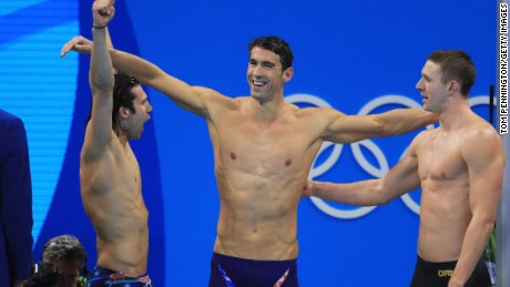 Cody Miller (left), Michael Phelps (center) and Ryan Murphy celebrate winning gold in the medley relay.