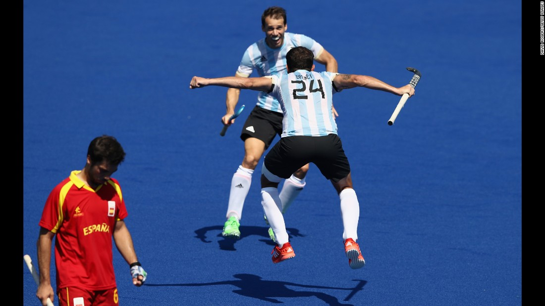 Facundo Callioni of Argentina celebrates with team mate Manuel Brunet after their 2-1 victory in a field hockey match against Spain.