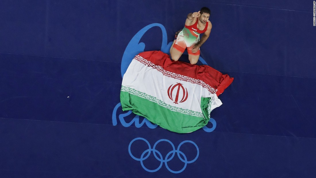 Iran's Saeid Morad Abdvali celebrates after winning the bronze medal in the men's Greco-Roman 75 kg competition.