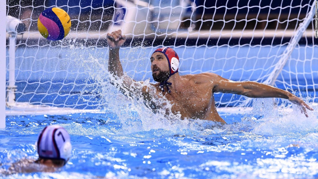 US goalie Merrill Moses saves a shot against Italy during in a men's water polo preliminary round match. The Americans won 10-7.
