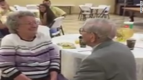 Harvey Wosika, 92, sings to his wife Mildred, 90, at their 50th anniversary party.