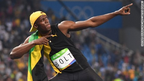 "Bolt does his ""Lightening Bolt' pose as he celebrates winning the 100 meters."