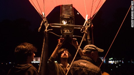 Crew members from Cameron Balloons participate in the Night Glow. The Bristol-based company is the largest manufacturer of hot air balloons in the world.