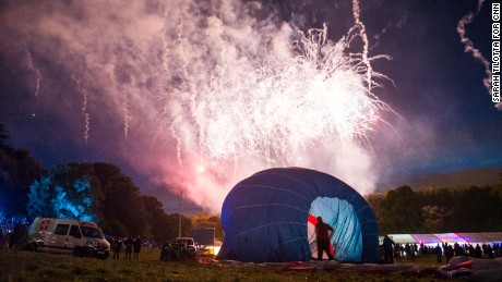 Following the Night Glow display, balloons are quickly deflated as a spectacular fireworks show begins.