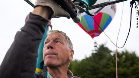 World champion balloon pilot David Bareford watches the positions of other balloons nearby.  Bareford and his co-pilot, John Coleman, explained that winds at different altitudes tend to move in different directions. The skill of a balloon pilot is in understanding this, they said.