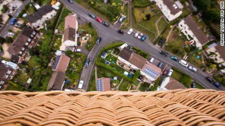 The wicker basket of the Fortnum & Mason balloon is seen high above the town of Long Ashton, four miles west of Bristol. Despite many decades of balloon manufacturing and development, traditional cane wicker is still the preferred material for balloon baskets, due to its lightweight and durable flexibility.
