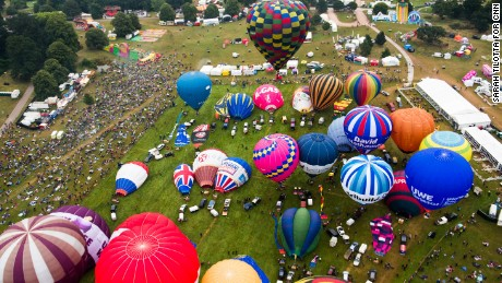 An aerial view of the launch field at Ashton Court shows balloons preparing for the mass lift Sunday