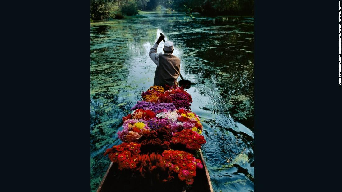 Flower Seller at Dal Lake by Steve McCurry