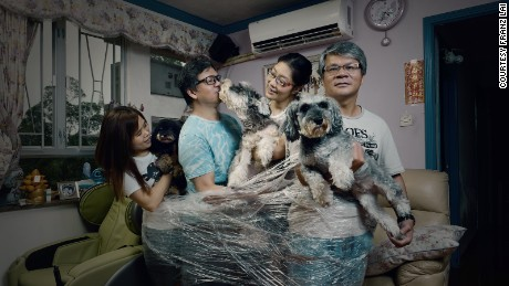 Franz Lai - 'Tied' Photography is a medium that suggests relationships between subjects simply by placing them together in the same frame. Lai drives this point home by asking his subjects to bind themselves together in a method and arrangement of their own choosing, as if to ask how we picture our own family ties.