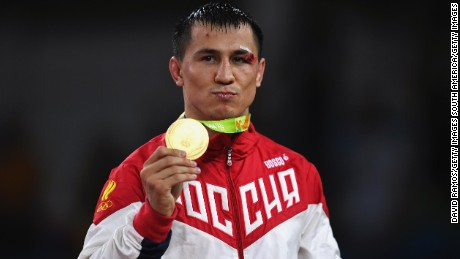 Roman Vlasov of Russia celebrates his victory during the medal ceremony on Sunday.