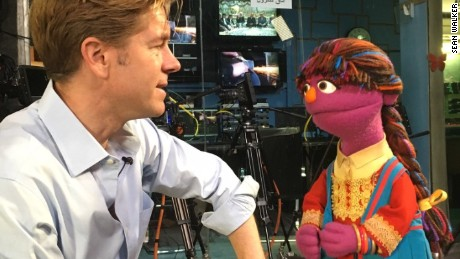 CNN's Ivan Watson talks with a Muppet.
