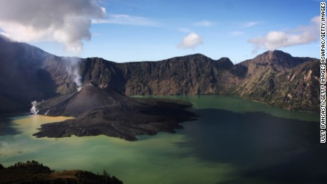 SENARU, LOMBOK, INDONESIA - MAY 19: A view of Mount Rinjani, also known as Gunung Rinjani, is seen on May 19, 2009 in Lombok, West Nusa Tenggara Province, Indonesia. The 3,726m active volcano is the third highest in Indonesia, and has been erupting this time around April 27, peaking on May 10. The volcano's crater lake, known as Segara Anak, is home to many goldfish and mujair fish and is a popular fishing spot for locals.  (Photo by Ulet Ifansasti/Getty Images)
