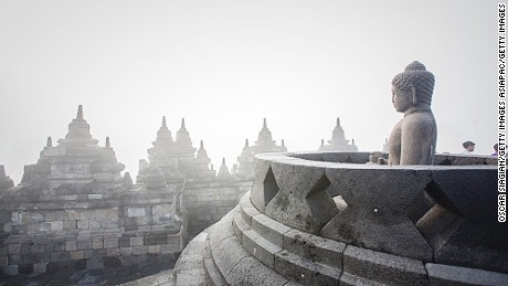 MAGELANG, INDONESIA - JUNE 02:  A Budha statue at Borobudur Temple on June 2, 2015 in Magelang, Indonesia. Buddhists in Indonesia celebrate Vesak at the monument anually, which makes it the most visited tourist attraction in Indonesia. It is observed during the full moon in May or June, with the ceremony centred at three Buddhist temples by walking from Mendut to Pawon and ending at Borobudur. The stages of life of Buddhism's founder, Gautama Buddha, which are celebrated at Vesak are his birth, enlightenment to Nirvana, and his passing (Parinirvana).  (Photo by Oscar Siagian/Getty Images)