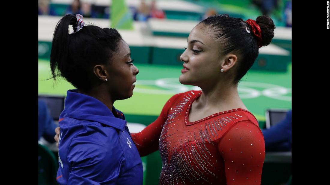 Biles is comforted by compatriot Laurie Hernandez, who got silver on the beam. Dutch gymnast Sanne Wevers won the gold.