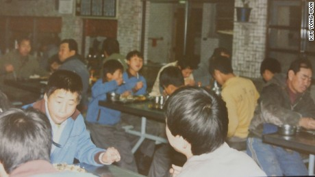 """Inmates eating at Brothers Home,  a state-subsidized welfare facility in the southern Korean city of Busan, operating in the 1970s and 1980s, and  created in the wake of presidential directives to clean up the streets and house """"vagrants"""" ahead of the 1988 Summer Olympics in Seoul."""
