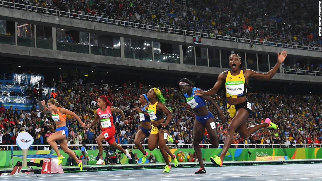 """Jamaica's Elaine Thompson, right, wins the 100-meter final -- and the title of <a href=""""http://www.cnn.com/2016/08/13/sport/elaine-thompson-olympic-games-rio-2016/"""" target=""""_blank"""">world's fastest woman</a> -- on Saturday, August 13."""