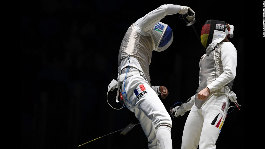 "A cell phone<a href=""http://www.cnn.com/2016/08/09/sport/french-fencer-drops-phone/"" target=""_blank""> falls out of the pocket of French fencer Enzo Lefort</a> as he competes against Germany's Peter Joppich on Sunday, August 7."