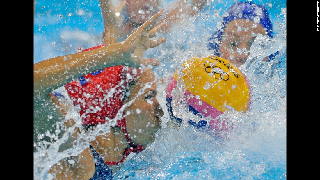 Hungarian goalkeeper Orsolya Kaso, left, competes against Australia in a water polo quarterfinal. Hungary won 13-11.