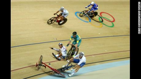 Elia Viviani of Italy, Glenn O'Shea of Australia and Sanghoon Park of Korea crash during the Cycling Track Men's Omnium Points Race