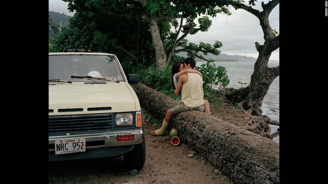 A couple kisses on the Hawaiian island of Oahu in 2014. Photographer Phil Jung wanted to get away from the cliche tourist spots and photograph what he saw as the real Hawaii.
