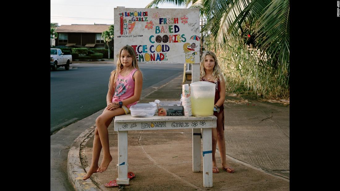 Girls sell lemonade and cookies.