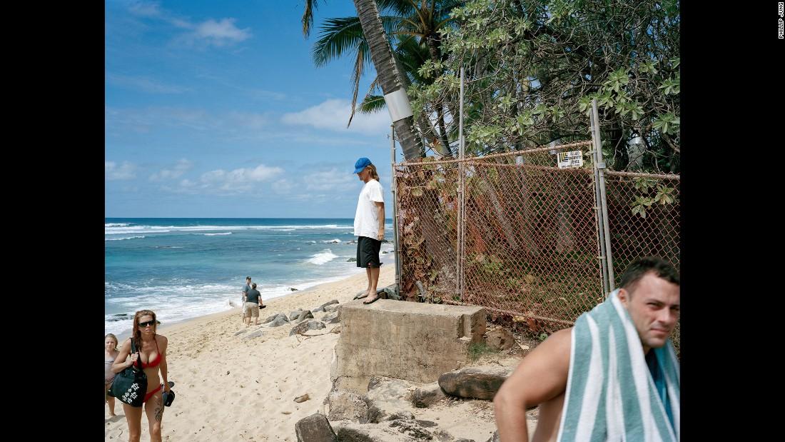 People visit a beach on Oahu.