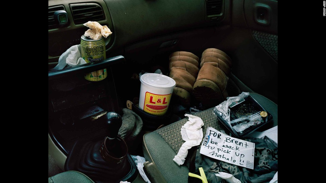 """The inside of one Hawaiian's car. """"I don't know this individual well, but it looks to me like he works pretty hard,"""" Jung said. """"He's got his boots in his car. You can tell he's got his L&L Hawaiian Barbecue (a famous local fast-food chain) and his can of Aloha Maid soda (a classic local beverage). He's got to eat in his car to get his lunch before he goes to his next job."""""""