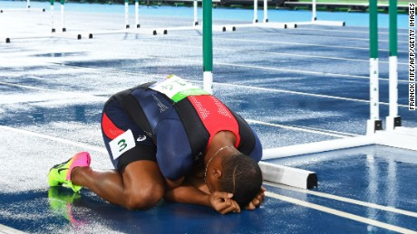 France's Wilhem Belocian falls to the ground after a false start in the Men's 110m Hurdles Round 1.