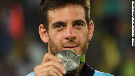 Silver medallist Argentina's Juan Martin Del Potro poses on the podium of the men's singles gold medal tennis event at the Olympic Tennis Centre of the Rio 2016 Olympic Games in Rio de Janeiro on August 14, 2016. / AFP / Martin BERNETTI        (Photo credit should read MARTIN BERNETTI/AFP/Getty Images)